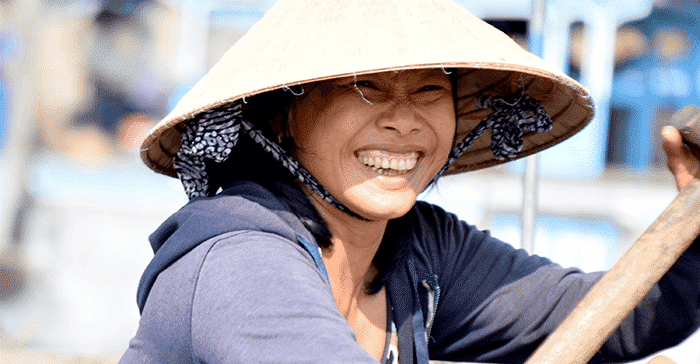 woman smiling in conical hat