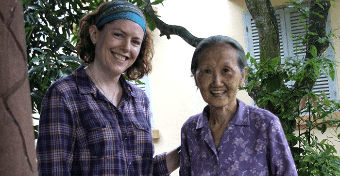 young woman standing with older woman both smiling