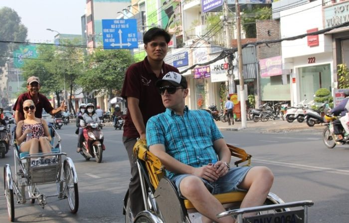 man being cycled on cyclo