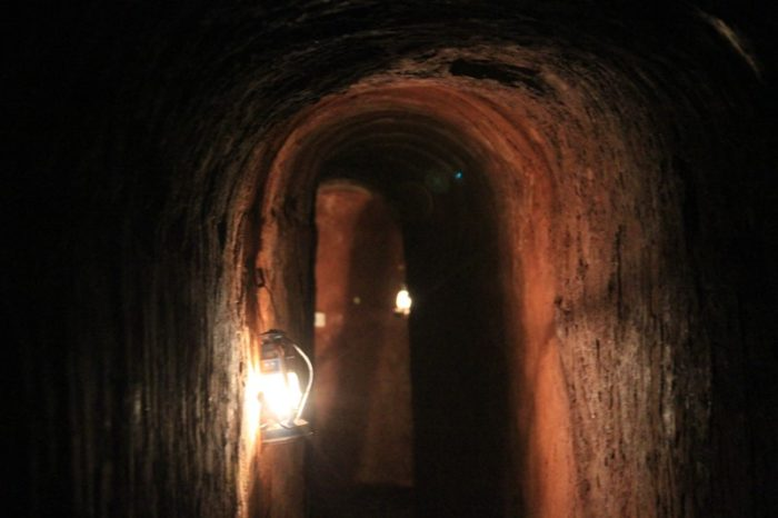 inside of tunnel with lantern