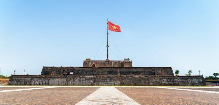 vietnam flag flying above building