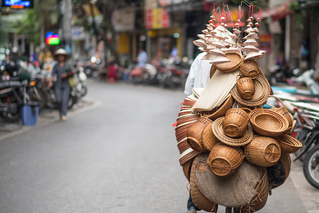 Person carrying their wares on their back