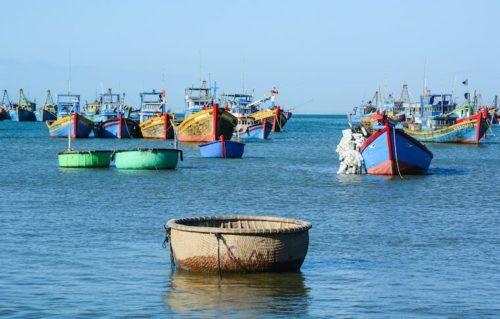 Fishing boats out on the water at at Ben Dam Village - Nha Trang