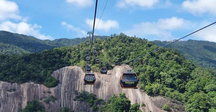 Two wires of cable cars climbing a hill