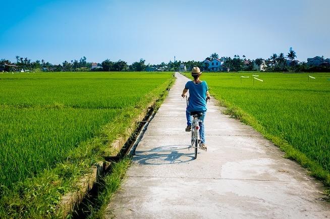 woman cycling in field