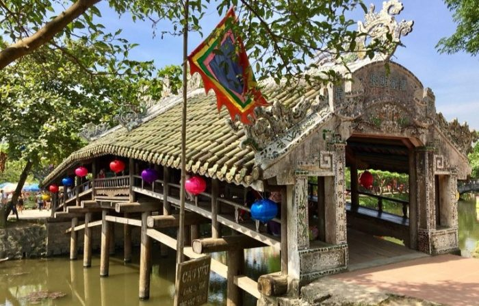 old covered bridge with tiles and lanterns