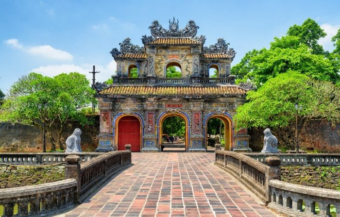 bridge leading to traditional asian gate